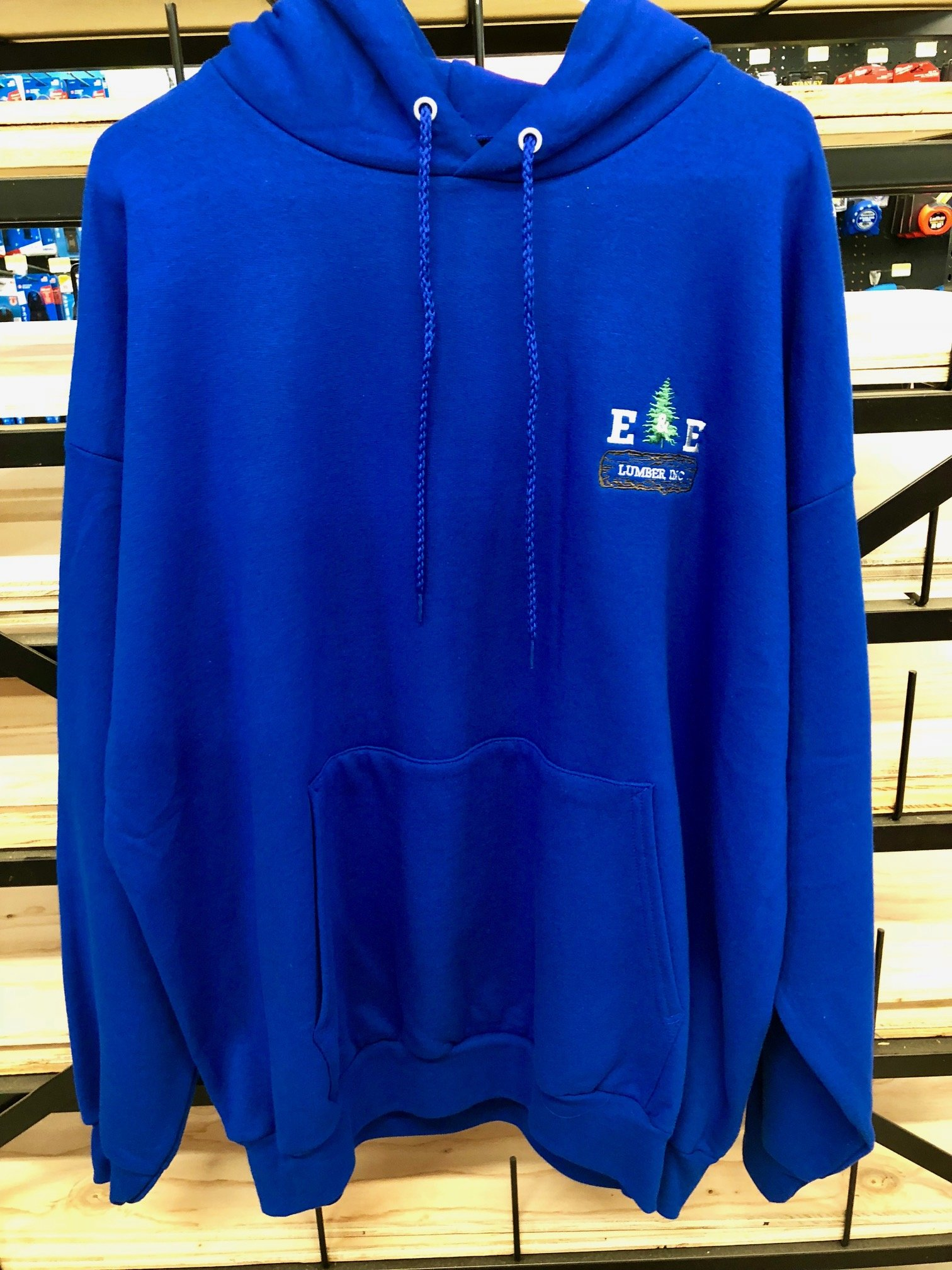 Blue hoodie hanging on a rack