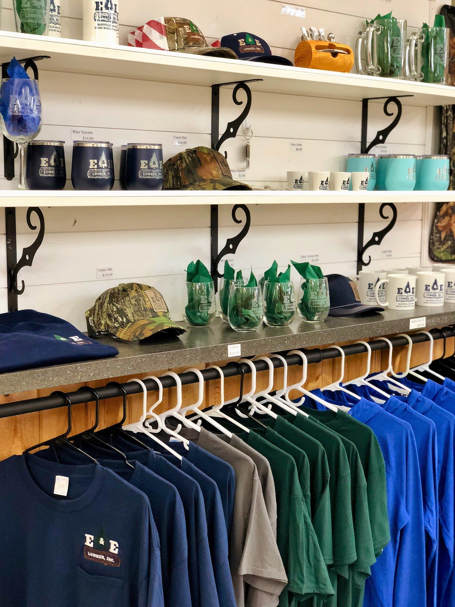 Group of accessories on shelves and hanging shirts